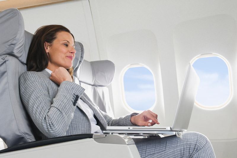business woman on plane